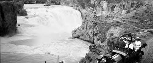 Shoshone Falls from south Idaho with early model Buick touring car. Photo taken in 1920.