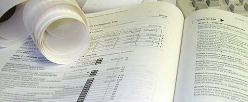 tax book, receipts, and keyboard